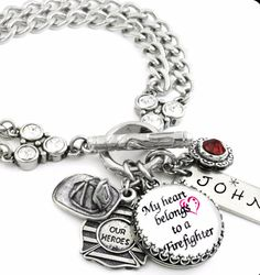 "This beautiful stainless steel double chain customized charm bracelet ""My Heart Belongs to a Fireman"" is masterfully crafted with your choice of crystal colors, and a hand stamped 316L stainless steel"