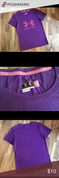"Under Armor T-shirt size M Description: Women's Purple Under Armour T-shirt. Clean. No stains, tears, or other damage that I️ could find. Material: Cotton Polyester Mix Measurements: 25"" Long, 18"" bust lying flat.  Non-smoking environment. Cat-friendly (not really, but he lives here and sneaks in the posh room when we're not looking) environment.  I try to ship within 24hrs of sale. I️ offer bundle discounts so feel free to look around my closet! Under Armour Tops Tees - Short Sleeve"