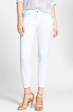 A bright white wash refreshes stretch-cotton skinny jeans with classic five-pocket styling cut for a breezy cropped silhouette.