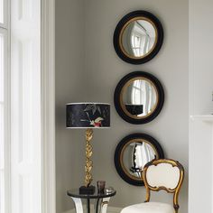 Perfect repetition of the same beautiful round mirror...replicate for less using ikea mirrors
