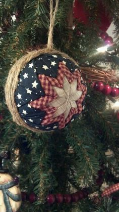 handcrafted styrofoam ball ornament ... red, white and blue with twine ... folded cloth star design ... luv the country look ...