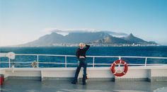 "Sail into Cape Town at dawn aboard an ocean liner. (Full disclosure; that's me on the late, lamented QE2. If I recall, that cloud is referred to as ""god's tablecloth."") #Jetsetter Curator"