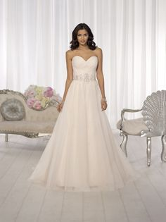 Fairy tale wedding gown! Beautiful sweetheart neck line, and the simple elegance we love. In store now! #sweetheartneckline #weddinggown #wolsfeltsbridal