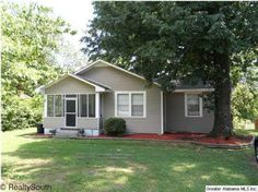 Great starter home with updates throughout. TRANE Heat/Air, updated appliances, some new cabinets, tile, fresh paint and carpet. Spacious rooms with high ceilings. Nice screened porch perfect for relaxing. Vinyl siding recently installed. Situated on almost an acre. Conveniently located just off the new I-22