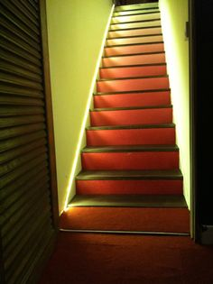 New lease of life for the stairs. Previously external, we moved the front wall of the house to bring the stairs within the living room. After seeing a pin on Pinterest, I painted them with an Ombré effect. The stairs go from the current home cinema up to living room, with LED strip lighting and con wood treads glued onto concrete. Stair Lighting, Street House, Home Cinemas, Led Strip, Phuket, Basement, Concrete, Porch, Castle