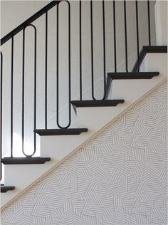 Modern railing on staircase and Miles Redd's Deconstructed Stripe in black by Schumacher set just the right scene in the front entry hall. Modern Stair Railing, Wrought Iron Stair Railing, Stair Railing Design, Staircase Railings, Modern Stairs, Stairways, Railing Ideas, Stair Spindles, Indoor Stair Railing