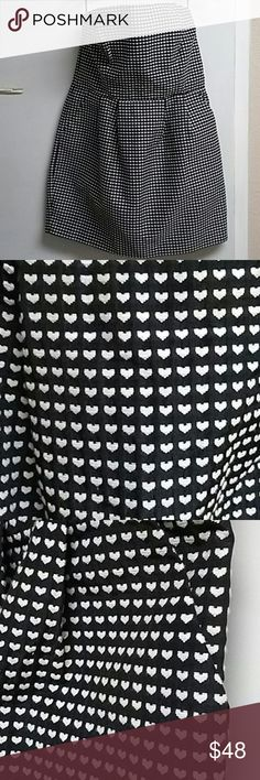 Adorable Rachel Roy black and white dress Absolutely adorable only worn once has bone in for support in the breast.  Has side pockets an invisible zipper on the left. Worn once in great condition RACHEL ROY Dresses Mini