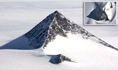 Conspiracy theorists have posted a video on YouTube, in which they claim that US Secretary of State, John Kerry, visited Antarctica last week to visit an 'alien base' within the pyramid.