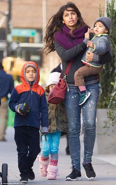 Mommy duty: His wife Camila Alves, meanwhile,  enjoyed an outing with their three children...