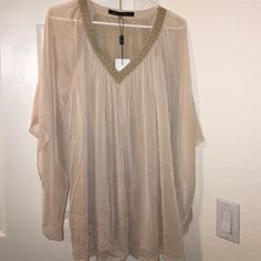 Women's blouse Tan women's blouse. V-Neck with a design.  Sheer material.  Arms are pure sheer (see through) never worn. Rose & Olive Tops Blouses