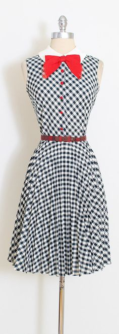➳ vintage 1960s dress  * black and white gingham print cotton * red buttons and bow * metal back zipper * pleated skirt * complimentary belt included  condition   excellent  fits like medium  length 40 bodice 17 bust 38 waist 28   ➳ shop http://www.etsy.com/shop/millstreetvintage?ref=si_shop  ➳ shop policies http://www.etsy.com/shop/millstreetvintage/policy  twitter   MillStVintage facebook   millstreetvintage instagram   millstreetvintage  5...