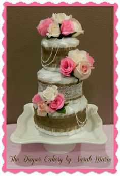 Vintage Chic Diaper Cake! https://www.facebook.com/diapercakerybysarahmarie?ref_type=bookmark #vintage cake #diaper cake #baby shower #gift #baby gift #cute #vintage chic #chic #diapers #center piece