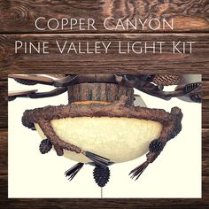 Rustic Lodge and Cabin Pinecone Ceiling Lighting Cabin Lighting, Ceiling Lighting, Rustic Lighting, Tree Lighting, Interior Lighting, White String Lights, Log Cabin Homes, Old Tools, Room Signs