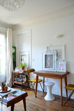 Kim's Small Space in Paris. Love the stool under the table for stow-away seating.