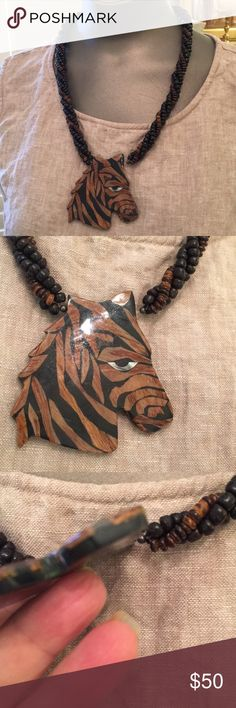 Truly a work of art inlaid wood horse choker Three inch fine art horse focal necklace stripes are alternating ebony wood and oak veneer applied in solid black   Fully sealed in clear lacquer. Twisted textured wood beads. Barrel twist closure. 1970s earthy vintage. vintage Jewelry Necklaces