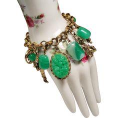 dea27e7aae9 Vintage Asian Figural Molded Jade Green Glass Bead Charm Bracelet