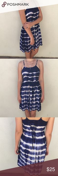 New Navy and white tie up dress Brand new with tags. Back laces up, tie-dye pattern. Super cute for the summer, dress up with jewelry :) Beach by Exist  Dresses