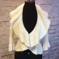 GORGEOUS CARDIGAN BY GUESS So soft and elegant. This pretty cardigan will be a perfect holiday sweater.. Excellent condition. It does shed due to it having angora in the material.. Sleeves are cropped.. Guess Sweaters Cardigans