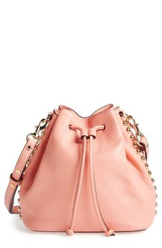 Goldtone studs edge up this chic, pink Rebecca Minkoff bag.