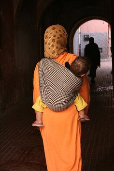Mother and baby, Morocco. Love the black background. Her clothing color stands out so nicely.