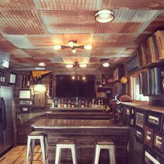 """Interior Design Inspiration - Dakota Tin ceiling tiles really helped bring together all the rustic industrial pieces in their bar. They skipped using a ceiling grid and fastened it directly, using the """"mostly rusty"""" mix of tiles. Interior Design Brief, Interior Design London, Interior Design Awards, Rustic Ceiling Tile, Tin Ceiling Tiles, Metal Ceiling, Corrugated Tin Ceiling, Corrugated Metal, Ceiling Grid"""