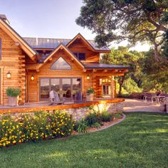 Log home with stone patio