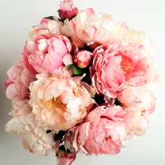 """Lovely"" is the best way to describe this arrangement. The highest quality soft pink and cream fully blossomed peonies are stunning and make this arrangement a must have. This arrangement is available"