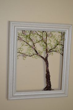 Framed Wall Art Jewelry Holder Wire Spring Tree with Leaves and Pink Blossoms -Useful Art. $70.00, via Etsy.