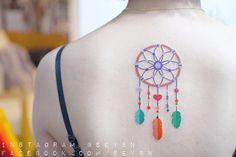 Beautifully colored dreamcatcher tattoo by Seyoon Gim