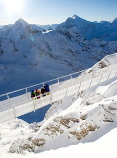 Titlis Cliff Walk, The Urner Alps, Switzerland - walk along the cliff on Mount Titlis.  The new suspension bridge is the ultimate highlight of the Swiss Alps.  Enjoy a unique experience at a height of 10,000 feet.