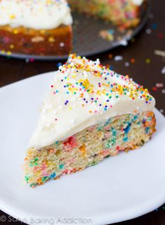 Ditch that boxed cake mix and make an Easy Funfetti Cake from scratch - tastes worlds better than the box too. And is easy to make. Frosting recipe included!