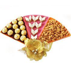 Raksha Bandhan 3 in 1 3 Milton microwave safe triangle platters comes with 200 grams of kaju katli, 200 grams of almonds and 16 pieces of Ferrero Rochers chocolates. Rs 2888/- http://www.tajonline.com/rakhi-gifts/product/r4570/raksha-bandhan-3-in-1/?aff=pint2014/