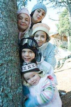 Google Image Result for http://www.colourbox.com/preview/1921464-811684-laurence-mouton-altopress-maxppp-group-of-teens-and-children-dressed-in-winter-clothes-posing-next-to-tree-portrait.jpg