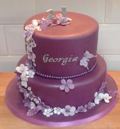 Purple cake with flowers and butterflies for a girl's 21st birthday