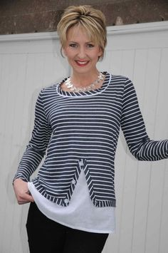 Interesting black & white sweater with white cotton hem. Very smart. From Brigid Foley.