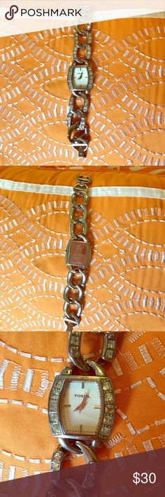 Fossil Watch Previously loved Rhinestone link Fossil Watch! All stones intact. Stainless steel and minor scratches from moderate wear but nothing major. Fossil Jewelry