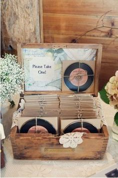 I love the idea of a mix CD as a wedding favor, especially with the labels and cardboard sleeves that make them look like an old 78.