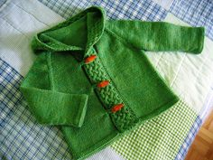 lovely little cardi.  $0 but may already have pinned. requires seaming. But very much like the cable detail.