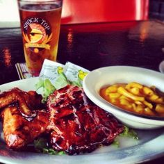 Ragin' Grill #tampa #Channelside #BombBBQ Tampa Restaurants, Sports Grill, Race Party, Milk Cookies, Cookie Frosting, Spare Ribs, Chinese Food, Chicken Wings, Barbecue
