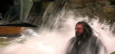 GIF: Dwarfs tumbling out of Thranduil's castle in their barrels. Kili can be majestic, too!