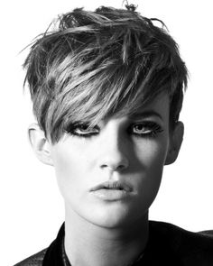 A short brown straight messy choppy hairstyle by Hair Associates