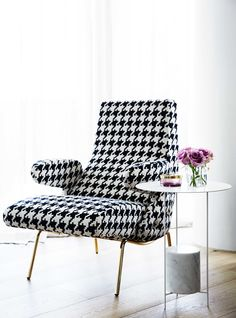 Hounds tooth chair in a living room