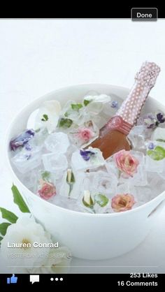 Super cute idea for brunch or a party. Roses frozen in ice cubes!