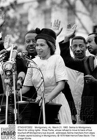 Montgomery, AL: March 21, 1965. Selma to Montgomery March for voting rights:  Rosa Parks, whose refusal to move to back of bus touched off Montgomery bus boycott,  addresses Selma marchers from steps of state capitol building in Montgomery. © 1976 Matt Herron/Take Stock / The Image Works
