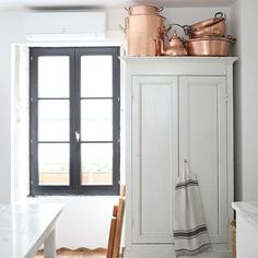 Love the white & copper - french country kitchen
