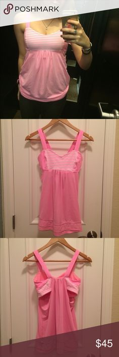 LULULEMON Tank Top with Built in Sports Bra Never worn and in great condition! Very cute tank top with a built in sports bra. Sports bra is pink and white striped and does not have padding. Tab at bottom of top to adjust the fit of the hem. Feel free to make reasonable offers! Size 4 lululemon athletica Tops Tank Tops