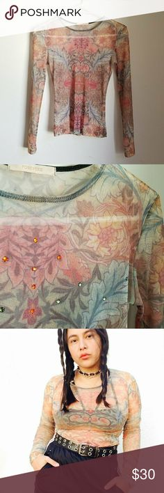 Vtg Y2K mesh lotus flower asian inspo grunge tee Vintage Y2K  mesh  floral lotus flowers semisheer rhinestones long sleeve stretchy top. No size tag. Will fit up to Medium. An oldie from Forever 21 (look at that tag ). It gives such cool bare skin / naked look   These tops are such troppers: they look great paired with strappy bralettes, under solid tees (for a tattoo sleeves inspo look), camis, satin dresses, overalls, pinafores... literally anything for a grunge witchy look. They are super…