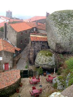 Monsanto, Portugal, a medieval village built around massive boulders. Places In Portugal, Spain And Portugal, Portugal Travel, Portugal Destinations, Places To Travel, Places To See, Places Around The World, Around The Worlds, Wonderful Places