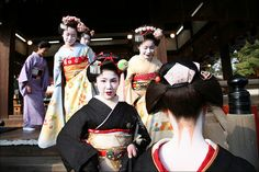 Japanese girls taking part in the mamemaki (bean-throwing ceremony) during Setsubun Festival
