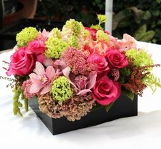 Roses, hydrangeas, orchids, hyacinth, rice flower and amaryllis.  $99.00